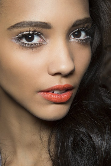 white eyeliner orange lips
